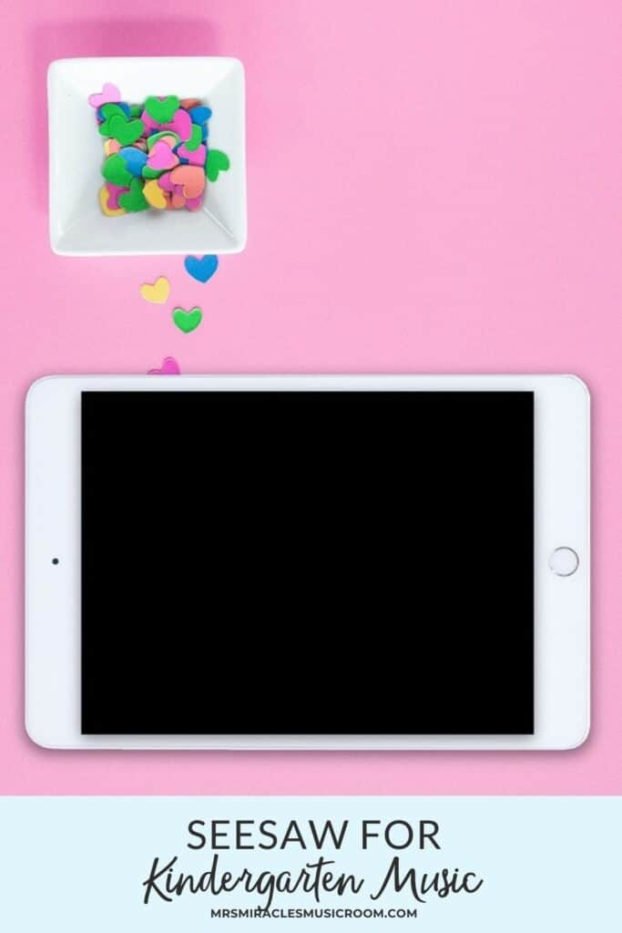 Ipad on pink background, with heart confetti
