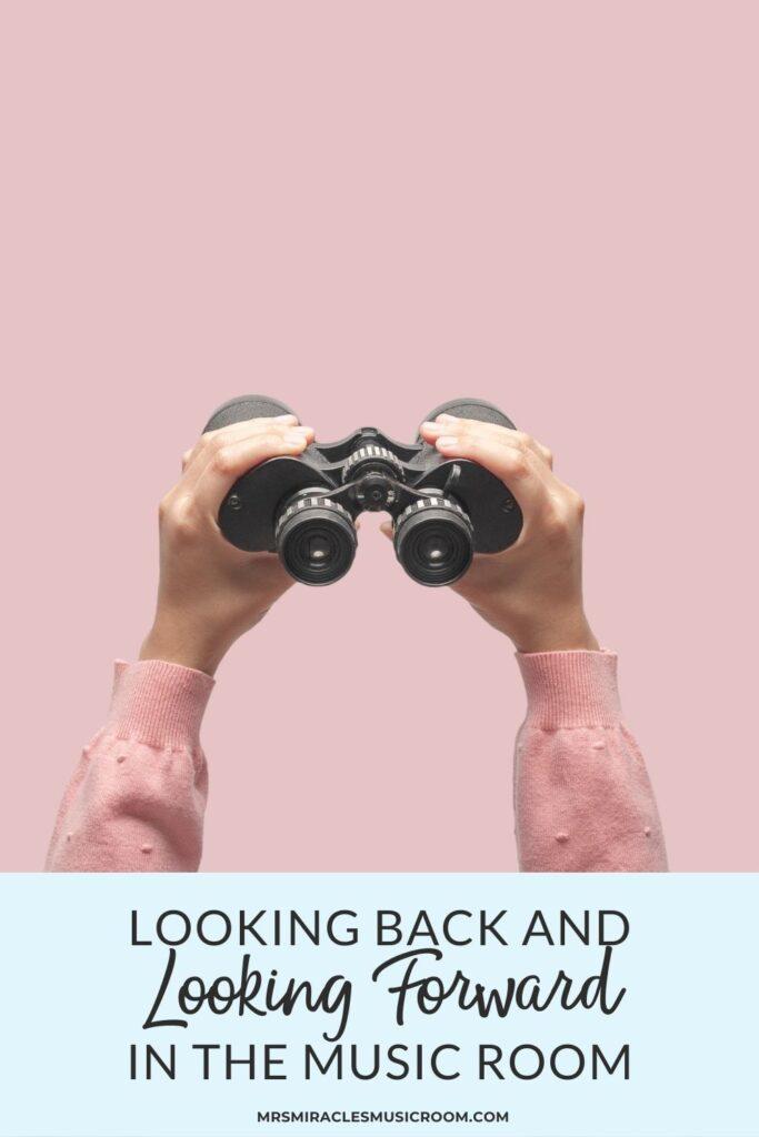 Hands holding up a binocular