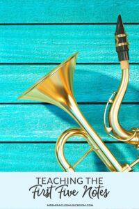 Trumpet and Saxophone on a teal wood background